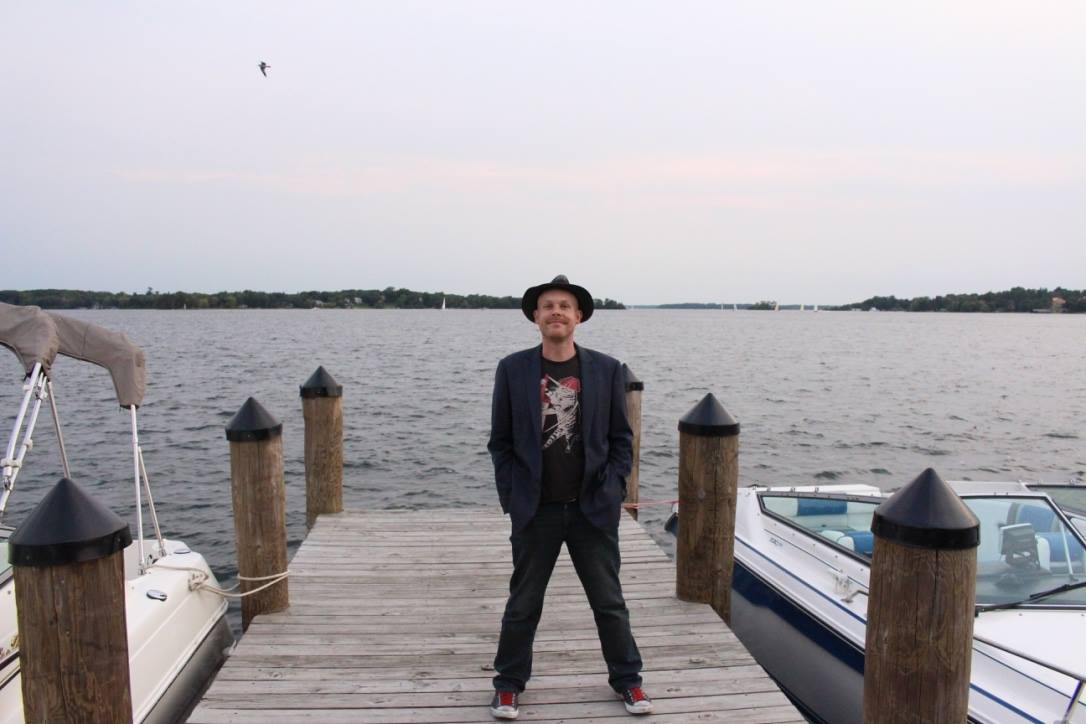 Band leader Adam on a pier with Lake Minnetonka (Minnesota) in the background
